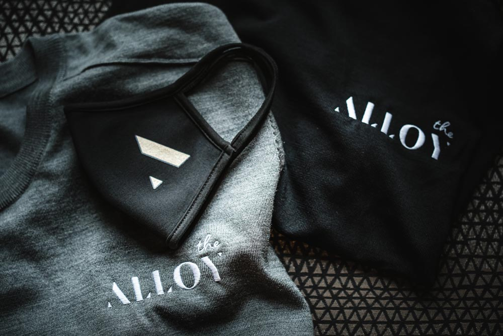 face mask featuring the alloy hotel branding